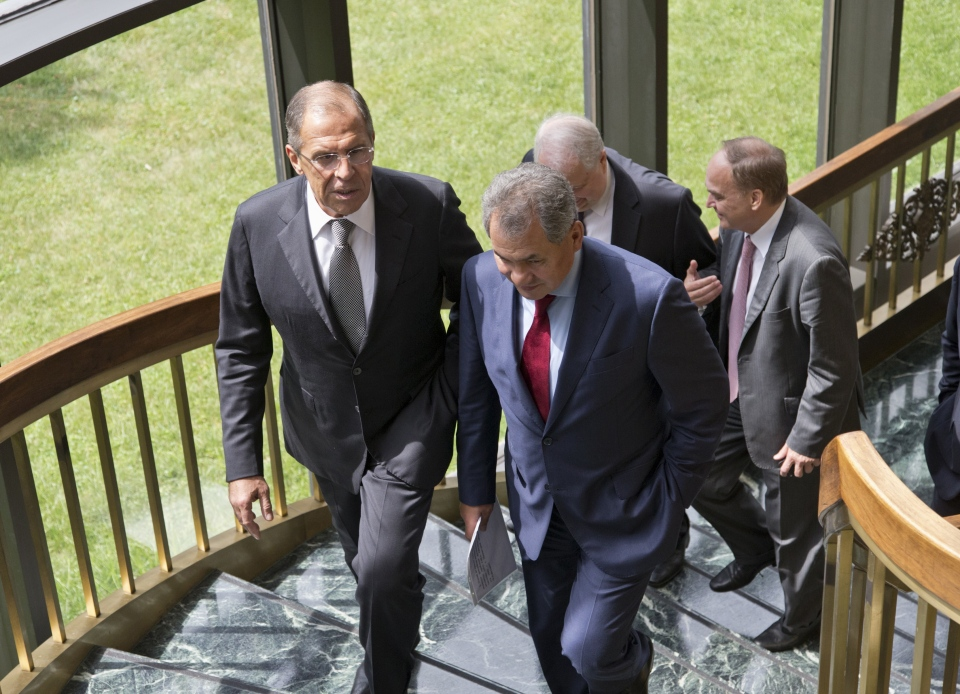 Russian Foreign Minister Sergei Lavrov, left, and Defense Minister Sergei Shoigu, right, walk to their news conference at the Russian Embassy in Washington, Friday, Aug. 9, 2013. (AP / J. Scott Applewhite)