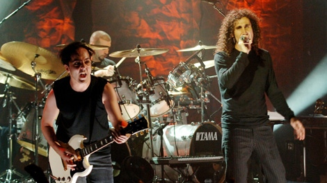 System of a Down lead singer Serj Tankian, right, guitarist Daron Malakian, left, and drummer John Dolmayan perform in New York in this Nov. 22, 2005, file photo. (AP Photo/Henny Ray Abrams)