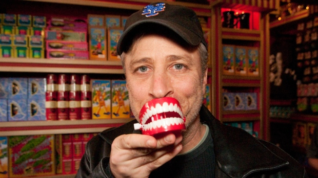 Comedian and TV personality Jon Stewart poses with a chattering teeth novelty toy while visiting Zonko�s joke shop at The Wizarding World of Harry Potter at Universal Orlando Resort on Tuesday, Feb. 8, 2011. (AP Photo/ Universal Orlando Resort, Roberto Gonzalez)