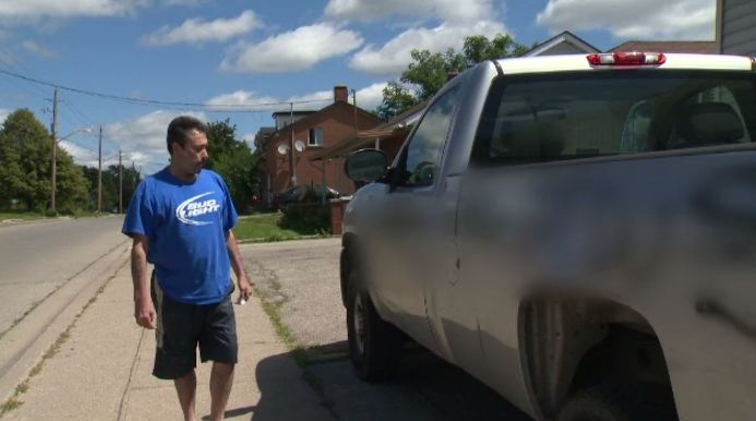 Cambridge resident surveys the damage to his car.