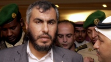 Palestinian government spokesman Dr. Ghazi Hamad, second left, surrounded by journalists and security men as he leaves after he held a press conference in a hotel in Mecca, Saudi Arabia, Islam's holiest city, Thursday Feb. 8, 2007. (AP / Hasan Jamali)