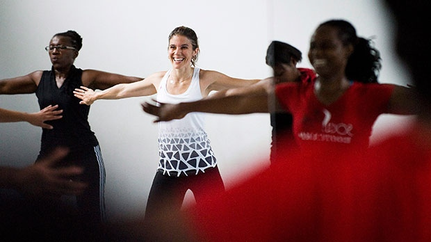 Rachael Kay, middle, dances during a Socacize class led by founder Ayanna Lee-Rivears, right, at the OIP Dance Centre in Toronto on Monday, July 18, 2011. (Aaron Vincent Elkaim / THE CANADIAN PRESS)