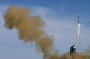 The Long March 2F rocket carrying the Shenzhou 10 manned capsule blasts off from the Jiuquan Satellite Launch Center in northwest China's Gansu Province, Tuesday, June 11, 2013. (AP / Andy Wong)