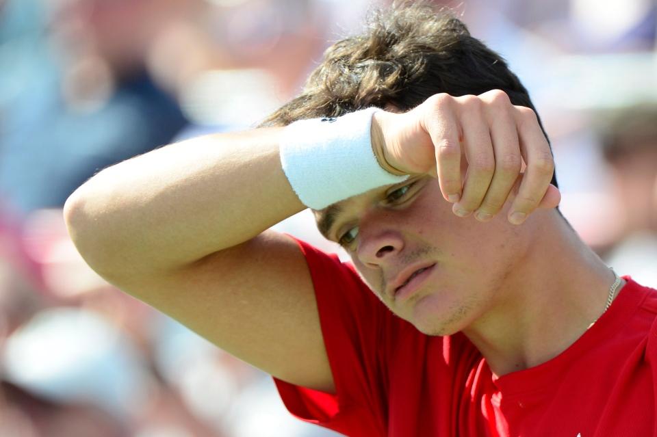 Milos Raonic reacts playing against Rafael Nadal