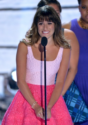 Actress Lea Michele speaks on stage at the Teen Choice Awards at the Gibson Amphitheater in Los Angeles on Sunday, Aug. 11, 2013. (John Shearer / Invision)