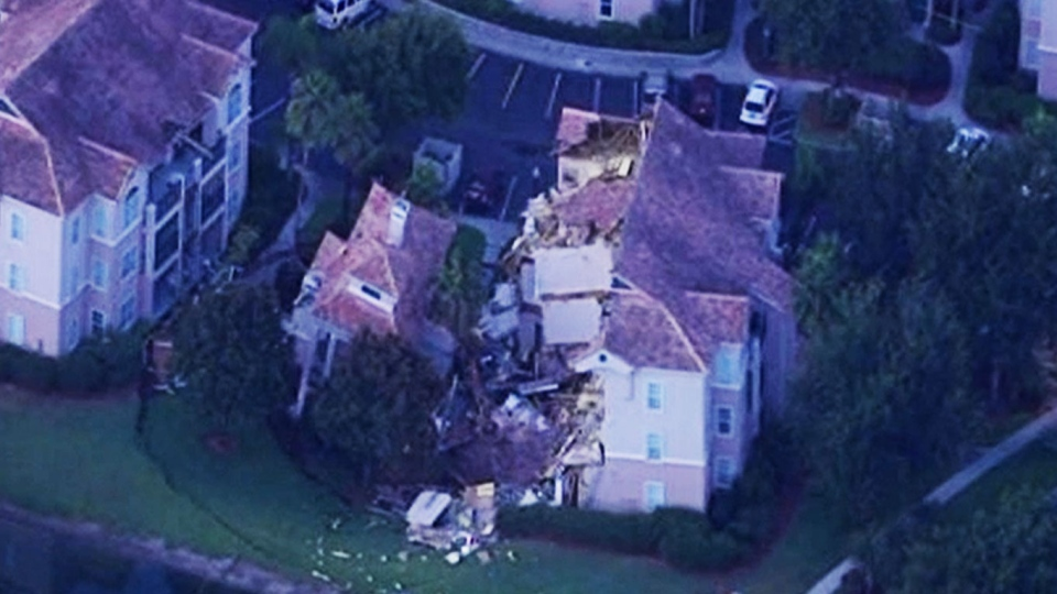 A sinkhole caused a section of a Florida resort villa near Disney World to partially collapse Monday, Aug. 11, 2013.