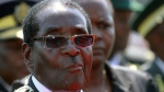 In this file photo, Zimbabwean President elect, Robert Mugabe is seen at the country's commemoration of Heroes day, in Harare, Monday, Aug. 12, 2013. (AP / Tsvangirayi Mukwazhi)