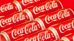 Cans of Coca-Cola are shown in Doral, Fla. on Monday, July 15, 2013. (AP / Wilfredo Lee)