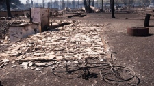 The smouldering remains of houses in Slave Lake, Alberta, on Monday, May 16, 2011. (Ian Jackson THE CANADIAN PRESS)