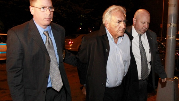 International Monetary Fund leader Dominique Strauss-Kahn, center, is brought into the Municipal Court, Monday, May 16, 2011 in New York.  (AP Photo/Julio Cortez)