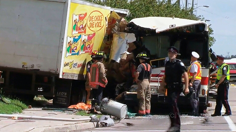 One woman is dead and several people injured after a front-end collision between a TTC bus and a cube van in Scarborough on Tuesday, Aug. 13, 2013.
