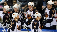 Atlanta Thrashers' Rob Schremp (13) and Evander Kane (9) celebrate Schremp's goal against the New York Islanders with teammates during the second period of an NHL hockey game in Uniondale, N.Y., Thursday, March 24, 2011. (AP-Kathy Kmonicek THE CANADIAN PRESS)
