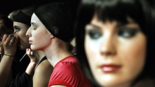 Models have their makeup done backstage during Toronto Fashion Week in Toronto, Tuesday, March 13, 2007. (CP PHOTO/Aaron Harris)