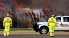 Officials monitor a wildfire in Slave Lake, Alta., Monday, May 16, 2011. (Michael Leonard / MyNews)