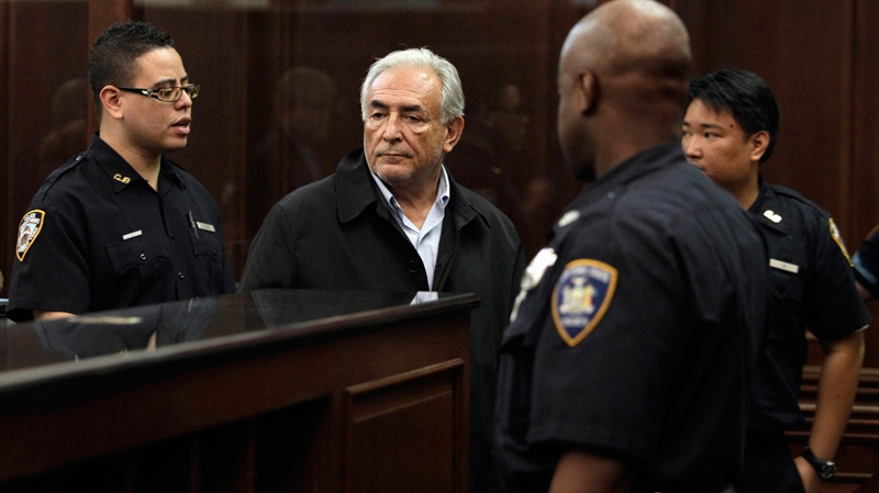 Dominique Strauss-Kahn, centre, head of the International Monetary Fund, waits to be arraigned in Manhattan Criminal Court, Monday, May 16, 2011. (AP / Richard Drew, Pool)