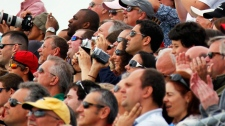 Spectators watch the space shuttle Endeavour lifts off from Kennedy Space Center in Cape Canaveral, Fla., Monday, May 16, 2011. (AP / Terry Renna)