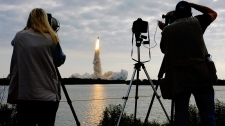 Photographers capture the launch of space shuttle Endeavour at Cape Canaveral, Fla., on Monday, May 16, 2011. (AP / J. David Ake)