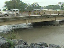Rising waters threaten a bridge in High River, Alberta on Saturday, May 24, 2008.