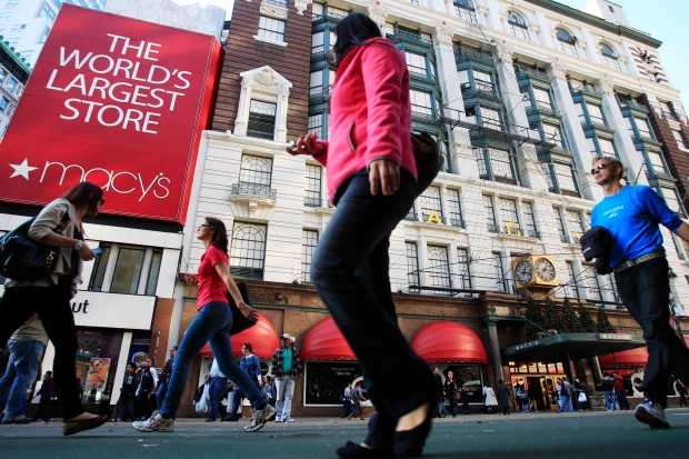 Pedestrians pass Macy's department store