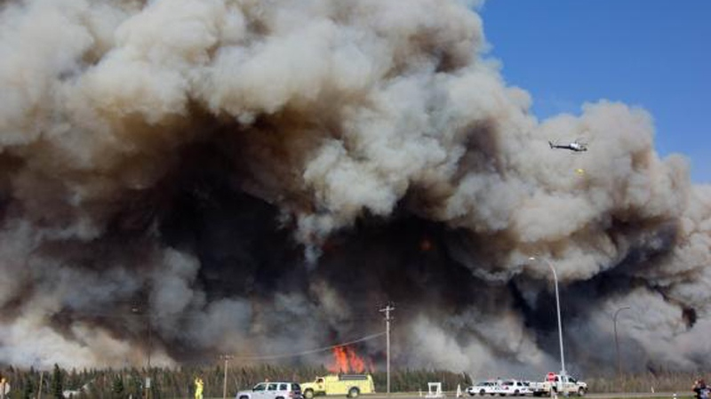 A wildfire rages in Slave Lake, Alta., Monday, May 16, 2011.
