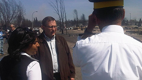 Premier Ed Stelmach gets a closer look at the devastation in Slave Lake on Monday, May 16, 2011.