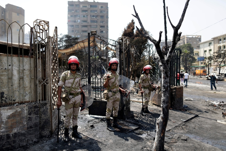 Egyptian army soldiers stand guard outside the Rabaah al-Adawiya mosque, in the center of the largest protest camp of supporters of ousted President Mohammed Morsi, that was cleared by security forces, in the district of Nasr City, Cairo, Egypt, Thursday, Aug. 15, 2013. (AP / Hassan Ammar)