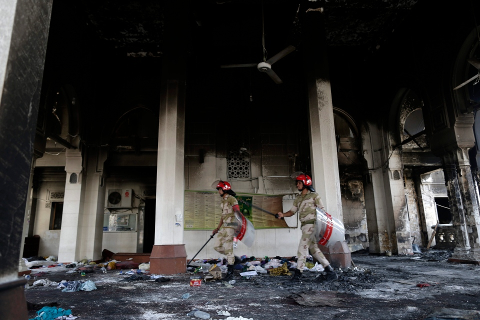 Egyptian Army soldiers walk among the charred remains of the Rabaah al-Adawiya mosque, in the center of the largest protest camp of supporters of ousted President Mohammed Morsi, which was cleared by security forces, in the district of Nasr city, at Nasr City, in Cairo, Egypt, Thursday, Aug. 15, 2013. (AP / Hassan Ammar)