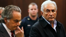 Dominique Strauss-Kahn, right, head of the International Monetary Fund, with his attorney Benjamin Brafman, is arraigned in Manhattan Criminal Court, Monday, May 16, 2011. (AP / Shannon Stapleton)