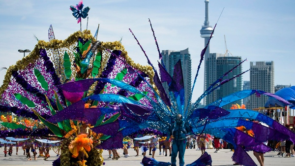 Revelers take part in the 2010 Caribana Parade in Toronto on Saturday, July 31, 2010. (Adrien Veczan / THE CANADIAN PRESS)
