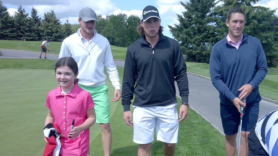 Tampa's Steven Stamkos, Anaheim's Matt Beleskey, and Tampa's BJ Crombeen hit the links before tonight's Hockey Night in Barrie. (Mike Arsalides / CTV Barrie)