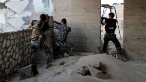 Syrian rebels open fire as they battle against the Syrian forces in Aleppo, Syria, Monday, Aug. 12, 2013. (Aleppo Media Center, AMC)
