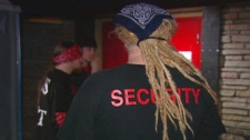 Brian Scheid, a bouncer at the Chainsaw Saloon, is seen outside the establishment in this undated image taken from video.