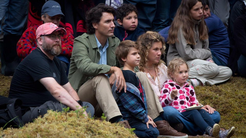Liberal leader Justin Trudeau, his wife Sophie Gregoire and their children Xavier and Ella-Grace attend a ceremony for the raising of the Gwaii Haanas legacy totem pole in Windy Bay, B.C., on Lyell Island in Haida Gwaii on Thursday Aug. 15, 2013. (Darryl Dyck / THE CANADIAN PRESS)