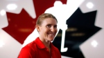 Canadian National Women's hockey player Hayley Wickenheiser, from Shaunavon, Sask., speaks to a reporter a news conference in Calgary, Alta., Monday, May 27, 2013. (Jeff McIntosh / THE CANADIAN PRESS)