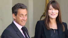 France's President Nicolas Sarkozy, left, his wife Carla Bruni-Sarkozy, right, are seen at the Elysee Palace in Paris, Friday, May 13, 2011. (AP / Michel Euler)