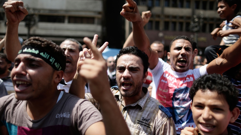 Supporters of Egypt's ousted President Mohammed Morsi chant slogans against Egyptian Defense Minister Gen. Abdel-Fattah el-Sissi before clashes broke out with Egyptian security forces in Ramses Square, downtown Cairo, Egypt, Friday, Aug. 16, 2013. (AP / Hassan Ammar)
