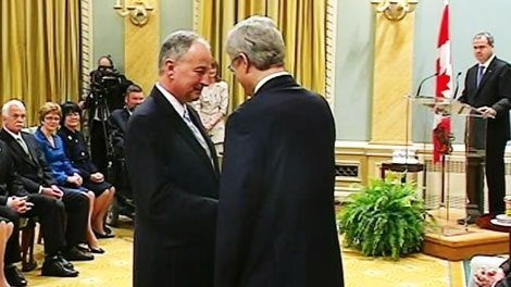 Minister of Justice Rob Nicholson shakes hands with Prime Minister Stephen Harper during the cabinet swearing-in ceremony in Ottawa on Wednesday, May 18, 2011.