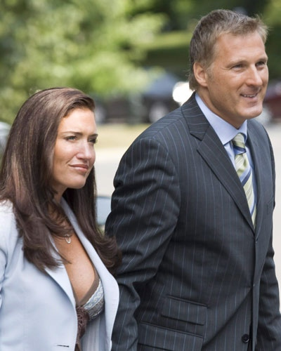 Maxime Bernier arrives to be sworn in as the minister of foreign affairs with Julie Couillard in Ottawa on Aug 14, 2007. (Paul Chiasson  / THE CANADIAN PRESS)
