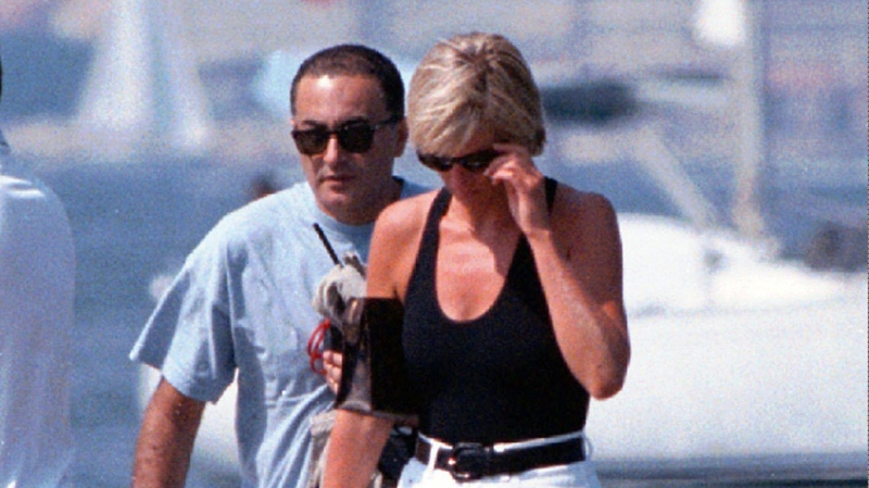 Diana, Princess of Wales, and her companion Dodi Fayed walk on a pontoon in the French Riviera resort of St Tropez in 1997. (AP / Patrick Bar-Nice Matin)