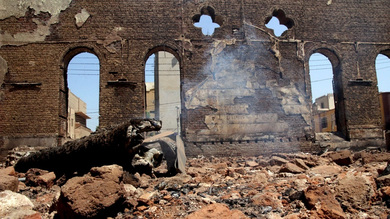 The smoldering ruins of the Evangelical Church of Malawi are seen after it was ransacked, looted and burned on Thursday by an angry mob, in Malawi, south of Minya, Egypt, Saturday, Aug. 17, 2013. (AP / Roger Anis, El Shorouk Newspaper)