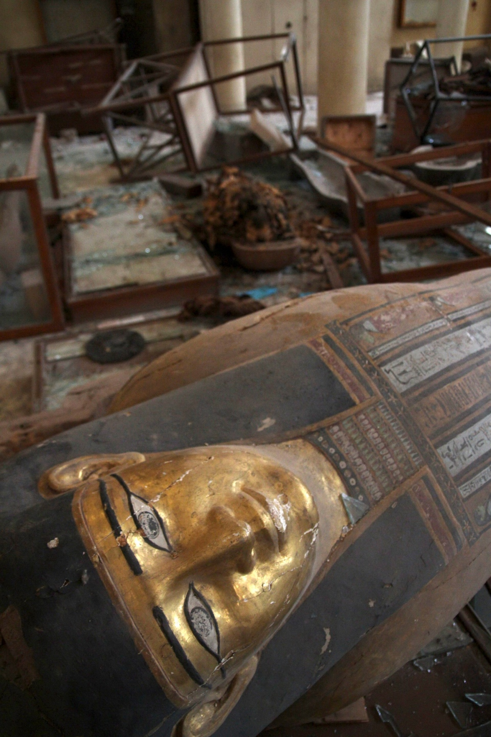 Damaged pharaonic objects lie on the floor of the Malawi Antiquities Museum after it was ransacked and looted in Malawi, south of Minya, Egypt, Saturday, Aug. 17, 2013. (Roger Anis / El Shorouk Newspaper)