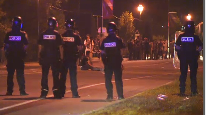 The rioters and police faced off in an unexpected disturbance north of Montreal Saturday night. (CTV Montreal Aug. 18, 2013)