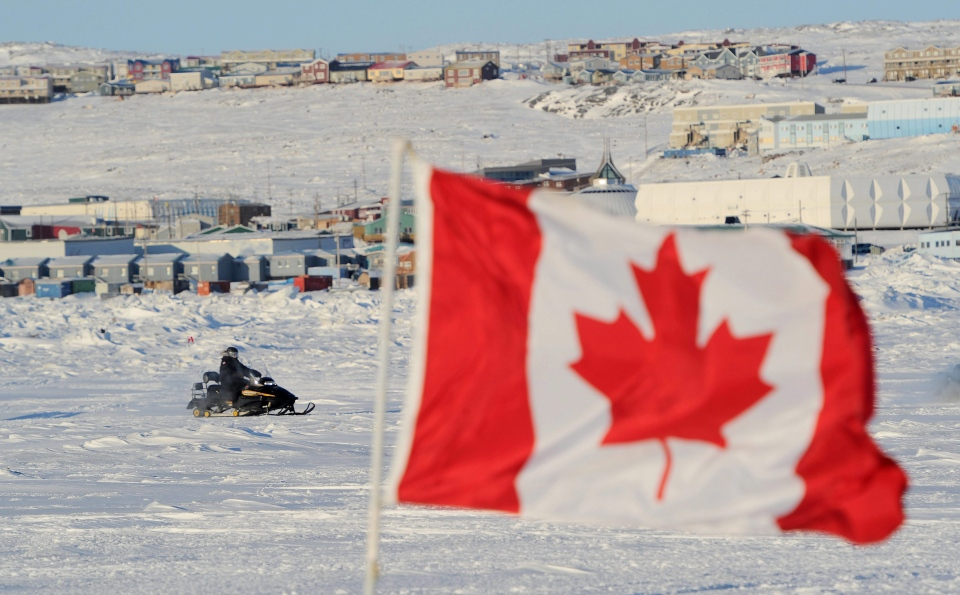 Prime Minister Stephen Harper rides a conventional snowmobile in Frobisher Bay in Iqaluit, Nunavut on Thursday, Feb. 23, 2012. (Sean Kilpatrick / THE CANADIAN PRESS)
