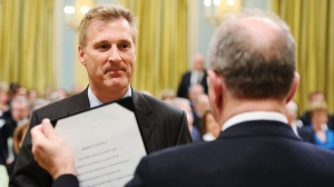 Maxime Bernier is sworn is as minister of state during a ceremony to announce the new federal cabinet at Rideau Hall in Ottawa on Wednesday, May 18, 2011. (Sean Kilpatrick / THE CANADIAN PRESS)