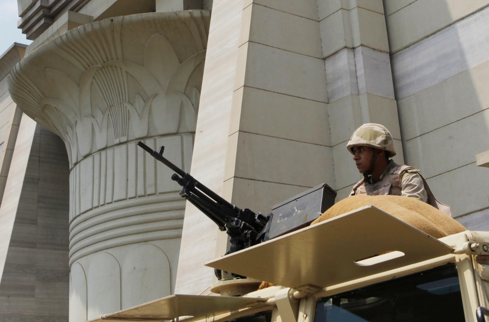 An Egyptian Army soldier takes his position on top of an armored vehicle as he guards in front of the Supreme Constitutional court in Cairo, Egypt, Monday, Aug. 19, 2013.  (AP / Amr Nabil)