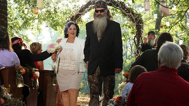 Miss Kay Robertson, left, and Phil Robertson renewing their vows in a