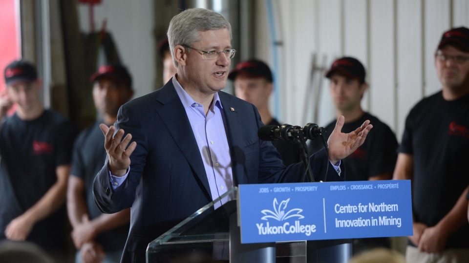 Prime Minister Stephen Harper delivers a statement at Quantum Machine Works Ltd., in Whitehorse on Monday, Aug. 19, 2013. (Sean Kilpatrick / THE CANADIAN PRESS)