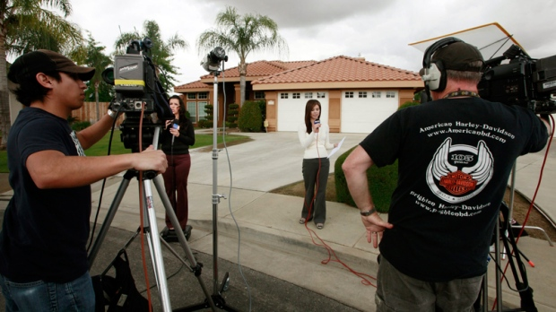 News media are shown outside the home believed to be the residence of a household staff member who mothered a child with former Gov. Arnold Schwarzenegger, Wednesday, May 18, 2011, in Bakersfield, Calif. (AP / Nick Ut)