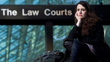 Toronto-based The Canadian Press journalist Olivia Pratten poses for a photo outside the B.C. Supreme Court in Vancouver, Wednesday, Oct. 27, 2010. (Jonathan Hayward / THE CANADIAN PRESS)