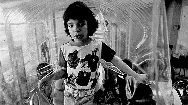 David Vetter poses inside of his bubble in his Houston home, Dec. 17, 1976. (AP Photo)